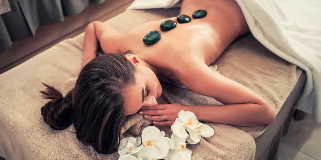 https://www.lereverittenhousespa.com/wp-content/uploads/2018/10/spa-stone-massage-3-1280x640.jpg